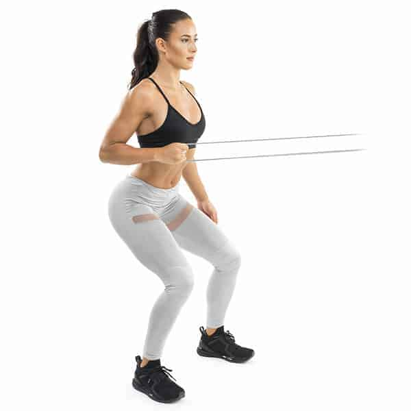 Female using resistance band for standing one armed row