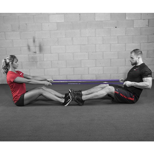 Male and female using resistance band in partnered workout
