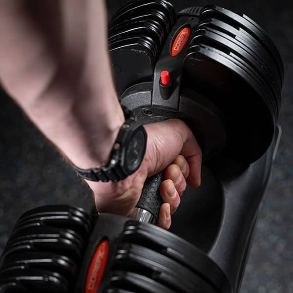 Lifting up the COREFX Adjustable Dumbbell Set