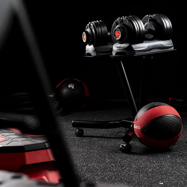 The COREFX Adjustable Dumbbells on the stand