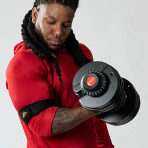 Athlete performing an Arm curl with the COREFX Adjustable Dumbbell