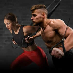 male and female using the suspension trainer