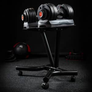 COREFX Adjustable Dumbbells on a stand